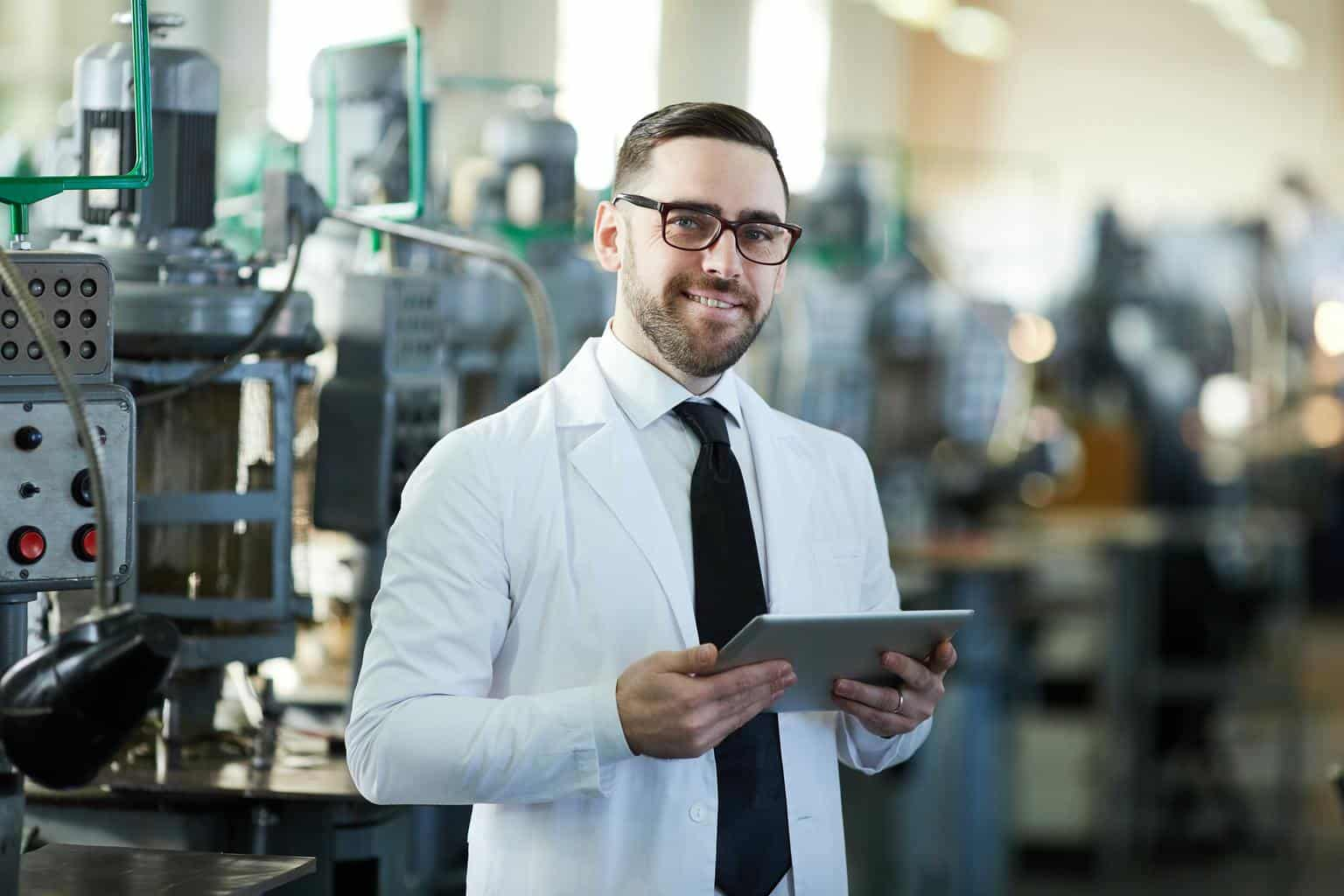 Handsome Factory Manager Holding Tablet
