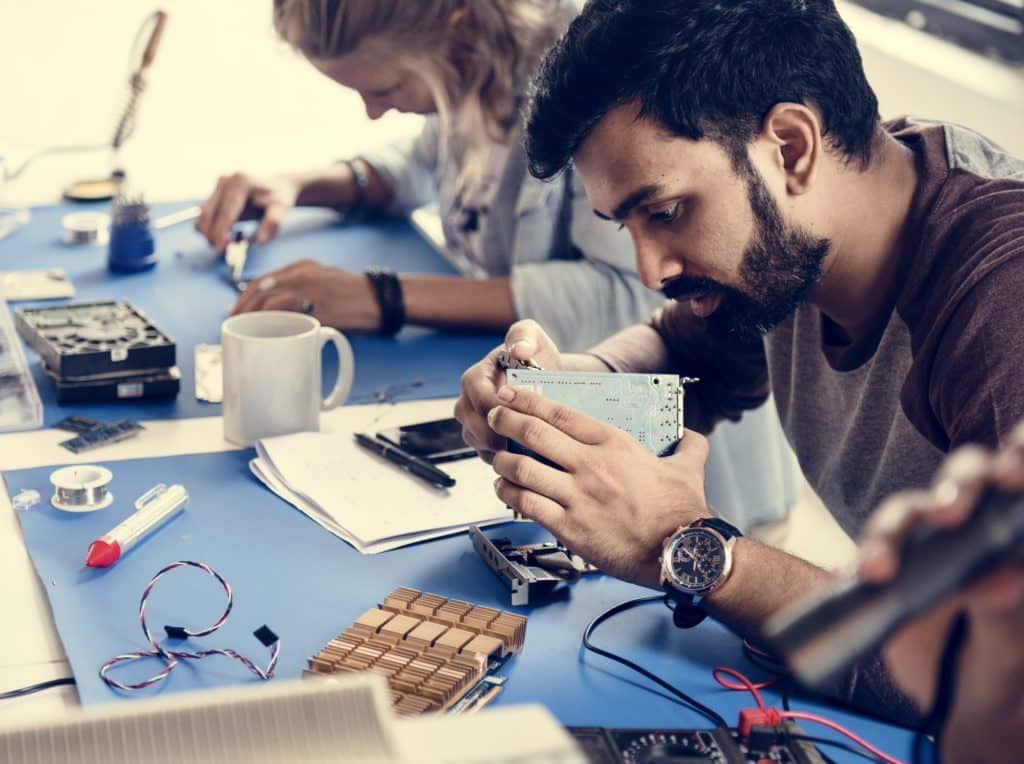 Electrical technicians working on electronics parts