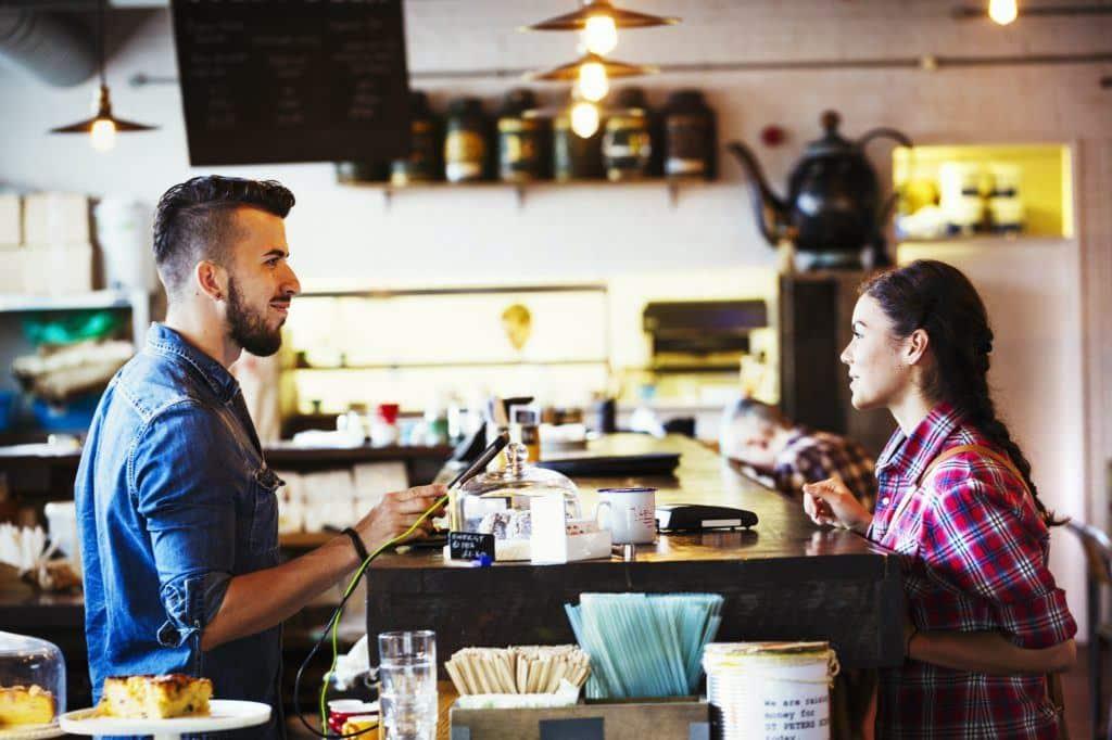 Starbucks and customer in coffee shop